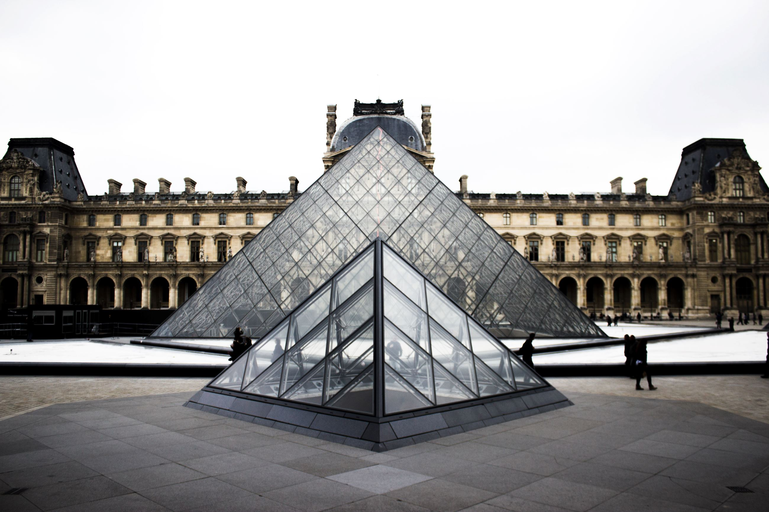 Louvre pyramids in paris Opens in new window